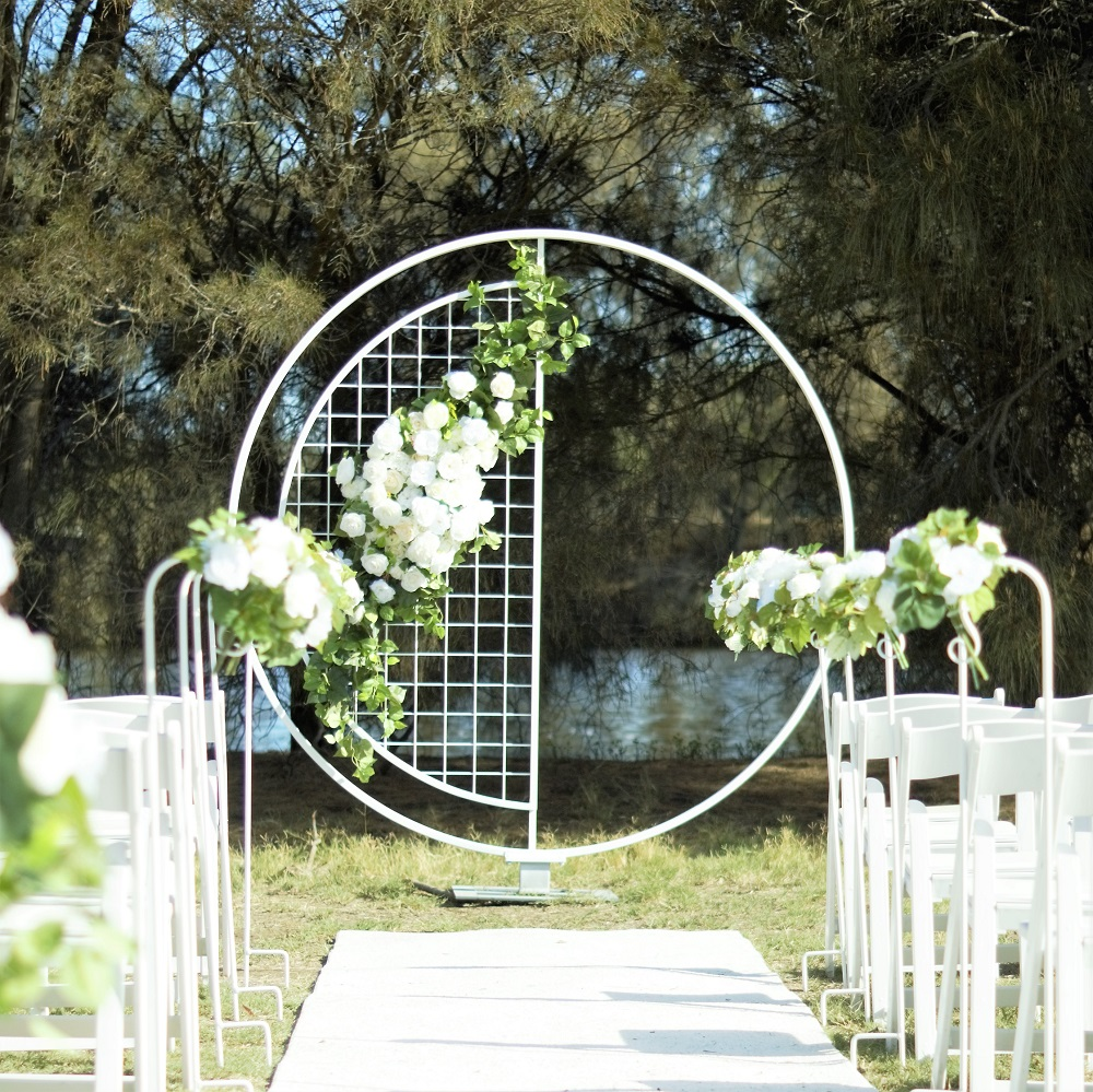 Ceremony Round with half mesh Arch sqr sml.jpg